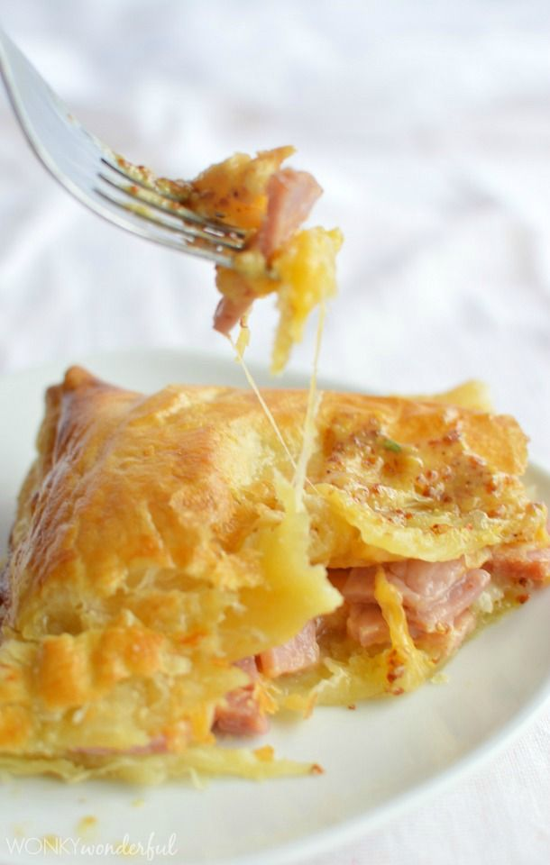 Ham and Cheese Puff Pastry Bake ~ perfect way to use your leftover ham... Chunks of delicious ham, mixed with melty cheese, baked in a flaky crust and served with tangy mustard dip!