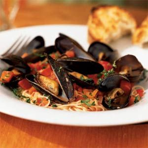This simple dinner of angel hair pasta with mussels is a delicious way to enjoy fresh seafood.  Sweet red peppers help balance the naturally salty mussels and the slightly acidic tomatoes.