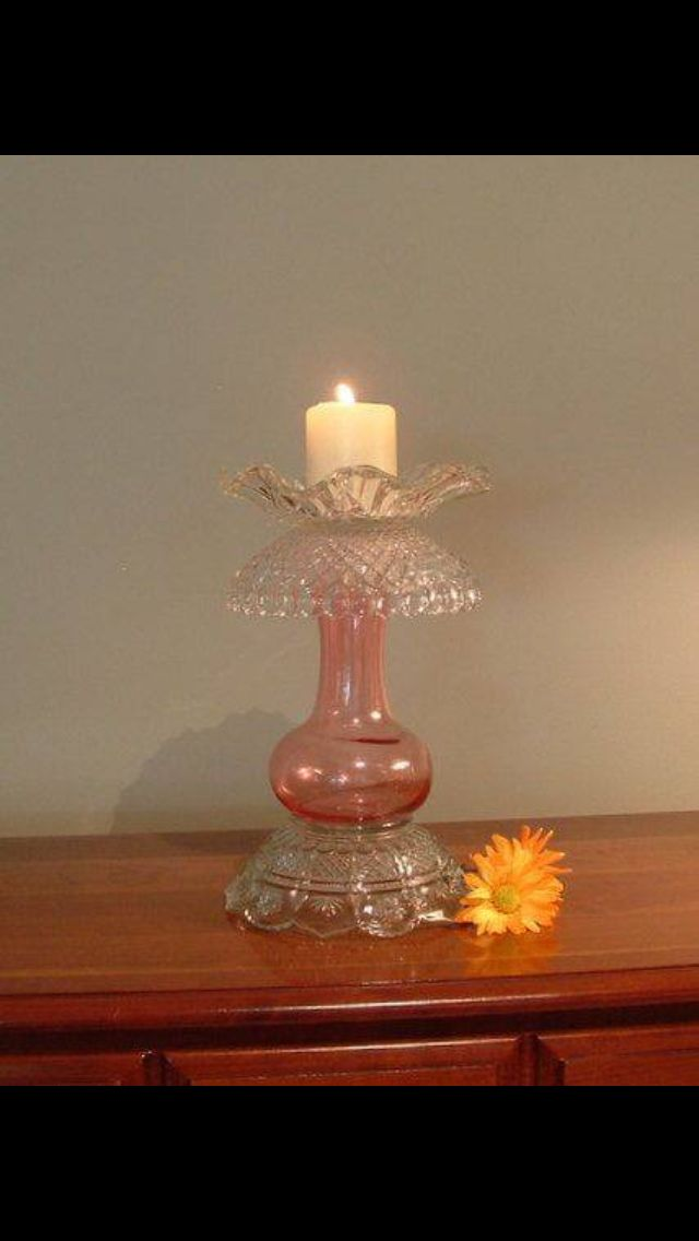 Candle holder by using glass pieces i.e. 3 glass bowls and a vase