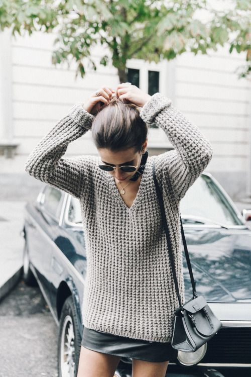Knit sweater + leather skirt.
