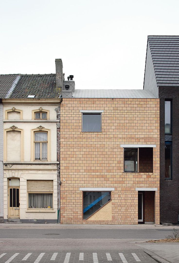 Subtle alterations  distinguish the Belgian  studio's work, such as in the new staircase  that can be glimpsed on the  street front