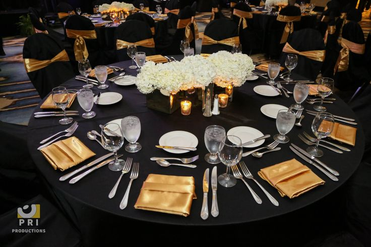 Black and gold color themed table for a dinner reception