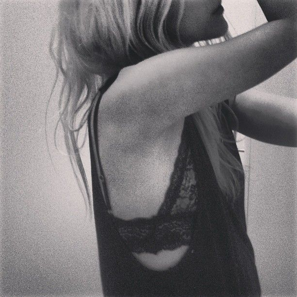 Lace bandeau peaking out under black tanks
