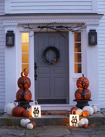 Like the stacked pumpkins with the trees painted on, could drill the holes in them and use christmas lights. Also like the sticks over the doorway, kind of like garland.