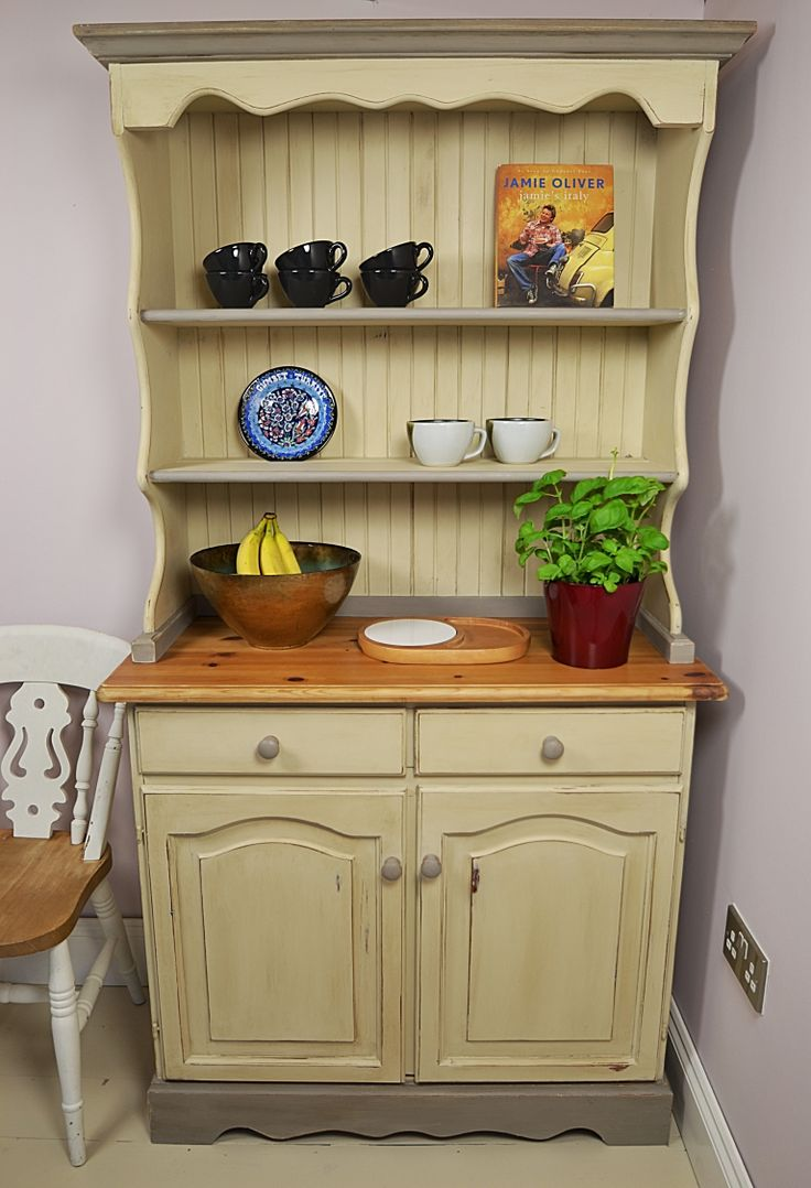 Short on space? This rather cute welsh dresser still provides ample storage without taking up too much of your kitchen! We've hand painted in Annie Sloan Old Ochre and French Linen and distressed and aged with dark and clear wax. We've lined the drawers with our very own grey flower wallpaper, designed by Eleanor Ross.