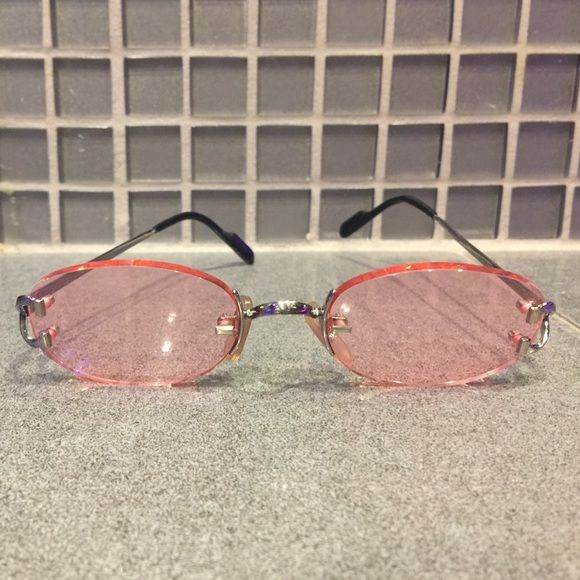 Authentic Cartier Rose Colored Glasses Auth Cartier glasses.  In mint condition. Worn 1x in a photoshoot. Seems a shame these have never got any love.  I'm hoping to sell to someone who will get some use out of them.  Comes with case. See the world through rose colored lenses.  Cartier Accessories Sunglasses