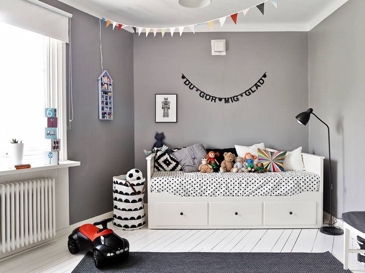This grey and white kids room is sophisticated yet still playful at the same time.