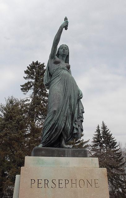 Persephone as torchbearer, guide, and beacon of hope. Butler University; Holcomb Gardens.