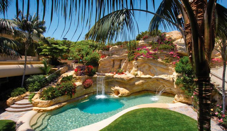Luxury pools with grotto grotto pools pinterest for Luxury swimming pools