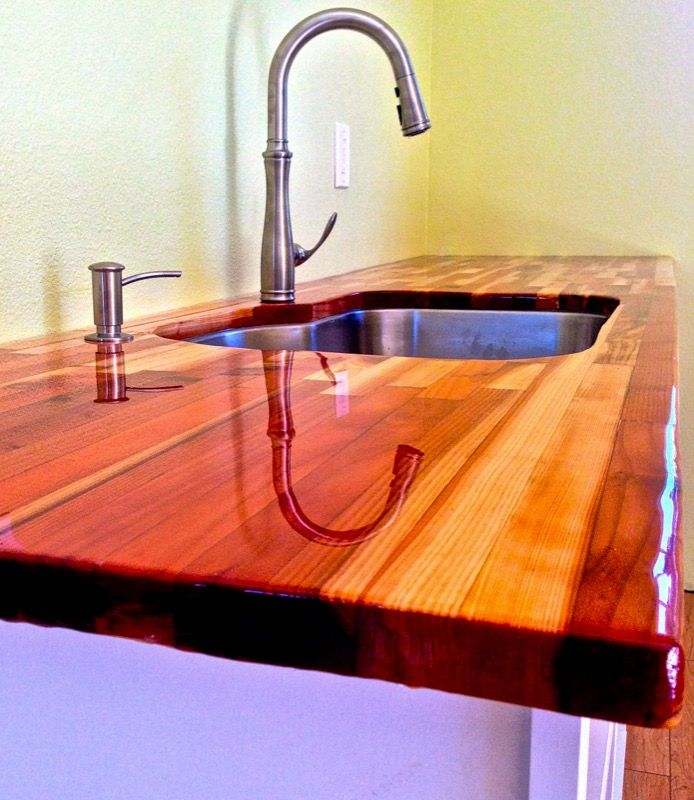 Epoxy Countertop Finish -As far as a coating goes, Litex makes a pour-on epoxy that is a super-high build like you'll see on bar tops. It is food safe once cured, according to the FDA. You wouldn't see it in bars and restaurants otherwise.