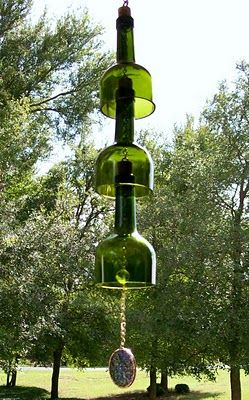 A #diy windchime made from repurposed winebottles. Guaranteed to kill squirrels and cut the shit out of your hands.  Make your neighbors green with envy be hanging these shards of glass around your house.  Also makes an useful flail for fighting off burglars and unwanted house guests!