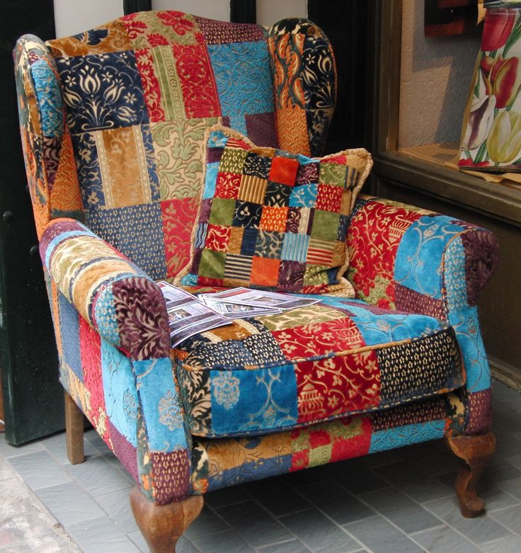 """Patchwork velvet chair, photo by Marjo (The Netherlands): """"In the Dutch city of Delft I saw this chair on the pavement, in front of an upholsterer's shop. What a great chair to quilt in, or to read, or daydream, or just to sit in!"""""""