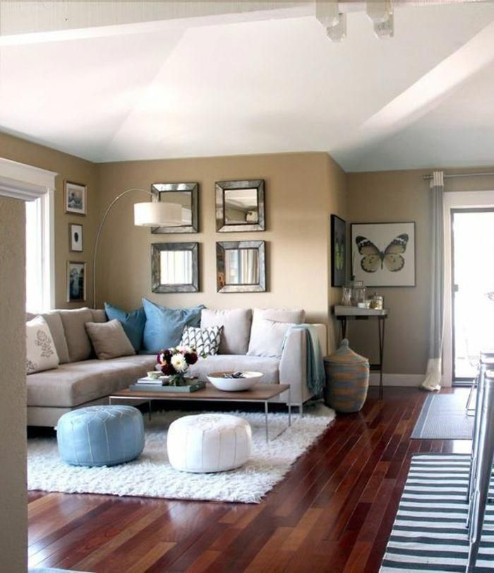 White Ceiling And Dark Wooden Floor Pale Brown Walls Big Light Grey Sofa With Blue Grey And Pa Living Room Rug Placement Living Room Color Rugs In Living Room
