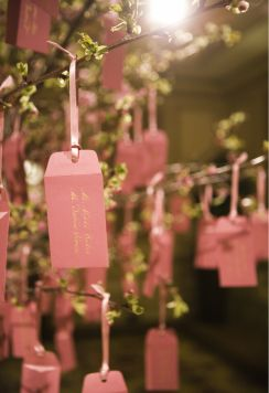 escort cards for seating + place own personal messages inside envelopes written in chinese + english for each guest