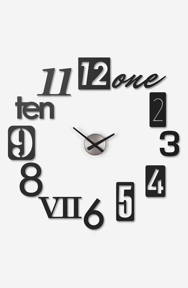 Add a stylish clock to your wall. I like the different ways they did the numbers!