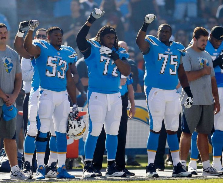 Titans vs. Chargers:  November 6, 2016   -  43-35, Chargers  -     San Diego Chargers players hold their fists in the air during the playing of the national anthem before an NFL football game against the Tennessee Titans Sunday, Nov. 6, 2016, in San Diego. The players are, from left, offensive guard D.J. Fluker, inside linebacker Joshua Perry (53), tackle Joe Barksdale (72) and offensive tackle Chris Hairston (75).