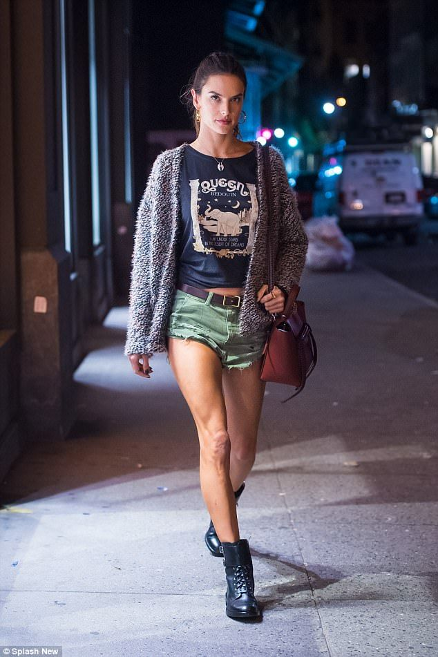 Wow factor:The 36-year-old model flashed her long toned legs in tiny olive hot pants for her solo outing