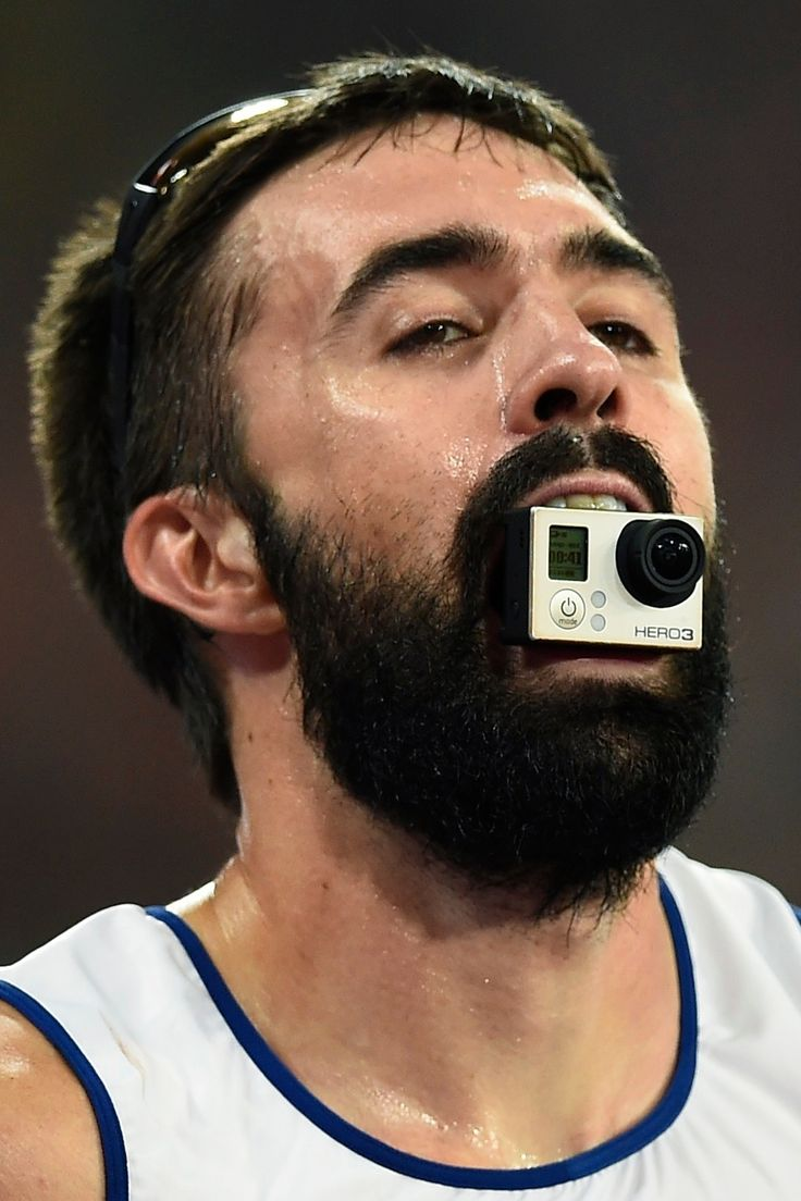The best images from Beijing, Great Britain's Martyn Rooney decides to hold a GoPro camera in his mouth after finishing third in the men's 4x400 metres relay final