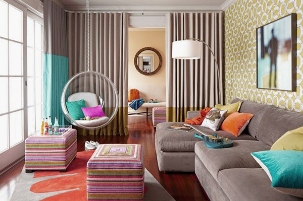 Youthful and FunTeen Room Design with Acrylic Hanging Chair, Cool Graphic Prints Wall, and Cozy Grey Sofabed Ideas