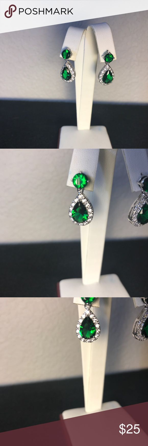 NWOT AAA Grade Green&White Zircon Platinum plated Absolutely stunning round and pear shape genuine Zircon. Plated with platinum, these earrings look like they cost a fortune! The color and sparkle are just incredible. They will not disappoint. If you, or someone you love is a Sagittarius, this is their birthstone!Zircon a mined from the Earth stone, it's not cubic zirconia, which is a fake diamond. (The two are often confused.) you will love these! Jewelry Earrings