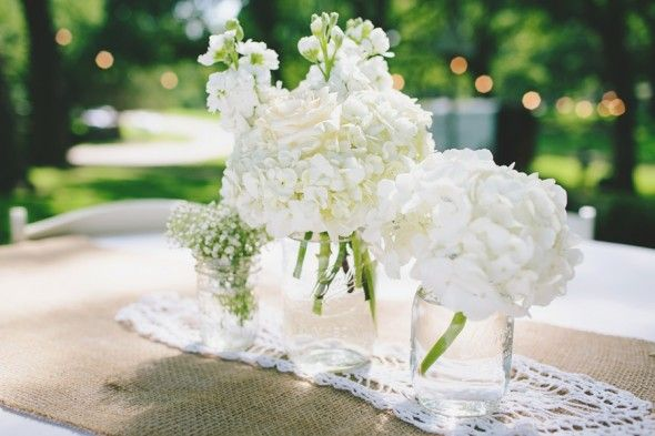 All white & Lace is the perfect combination for flower centerpieces! #wedding #flowers #white #lace