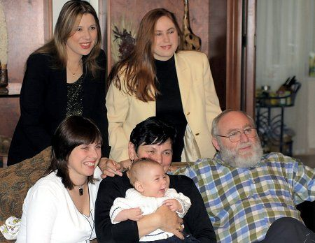 A recent picture of the entire Polgar family: Susan and Judit (standing), Sofia,   mother Klara, father László and a gleeful baby Oliver