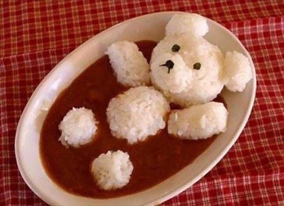 Rice bear bathing in tomato sauce :) Make good food look fun & the kiddos will eat it!