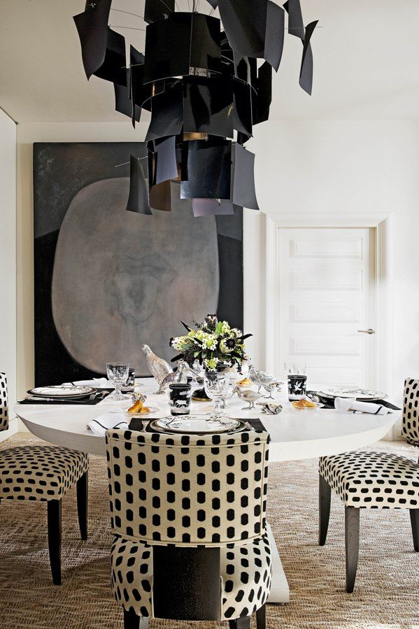 Amazing Graphic in black and white dining room.   We love the Lighting for Interior Design Ideas.  #interiordesign #luxuryfurniture #decorex2015 More inspirations visit us at www.covetlounge.net