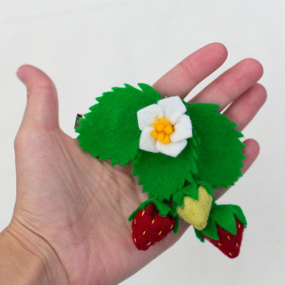 Handmade strawberry hair clip from Babes in the Woods. $15