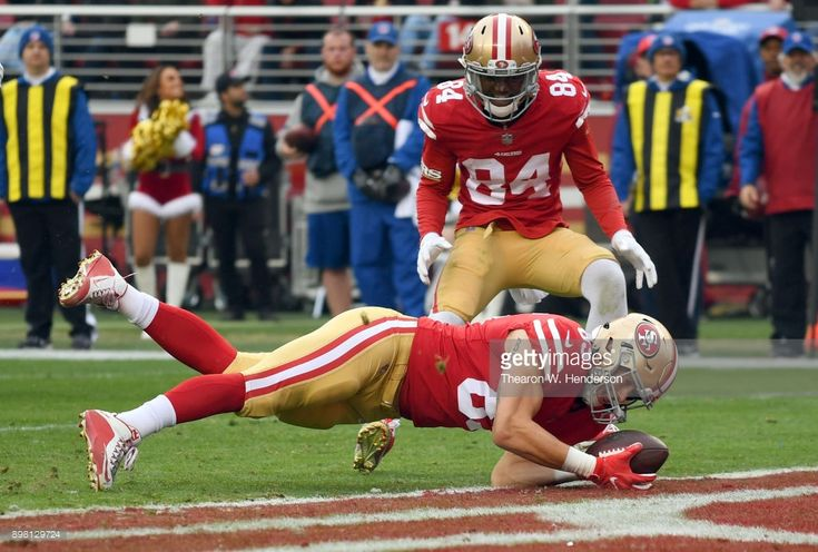 News Photo : George Kittle of the San Francisco 49ers dives...