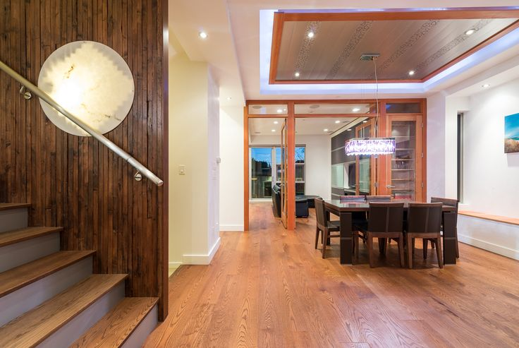 Looking past stained wood feature wall with in-set lighting to Dining Room & TV Lounge
