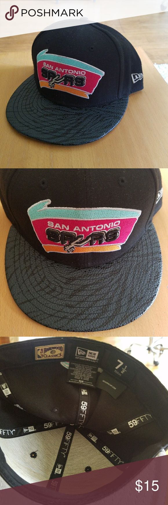 Spurs hat San Antonio Spurs hat with design print on the front. Fitted hat. Size 7 1/2  Please feel free to make a resonable offer! New Era Accessories Hats