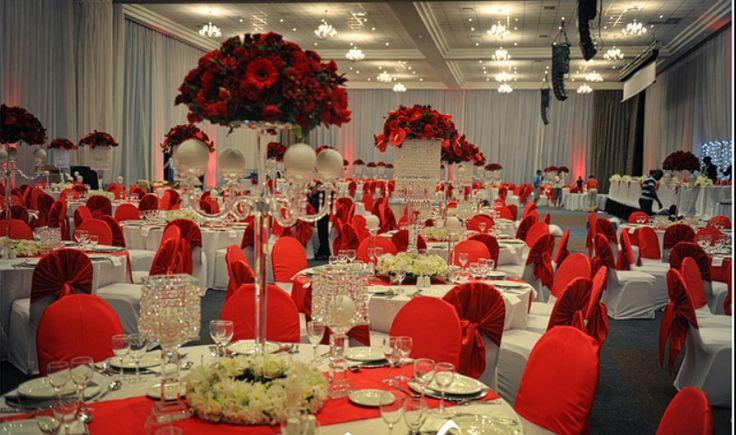 Crystal candelabra with red rose flower arrangements