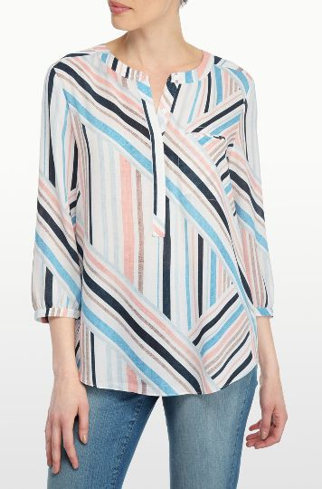 NYDJ's Printed 3/4 Sleeve Blouse features a beautiful stripe print against a striking white base. Pair this flattering silhouette with your favorite NYDJ's for a stylish everyday look. With a front chest pocket, and pretty pleating at the back.