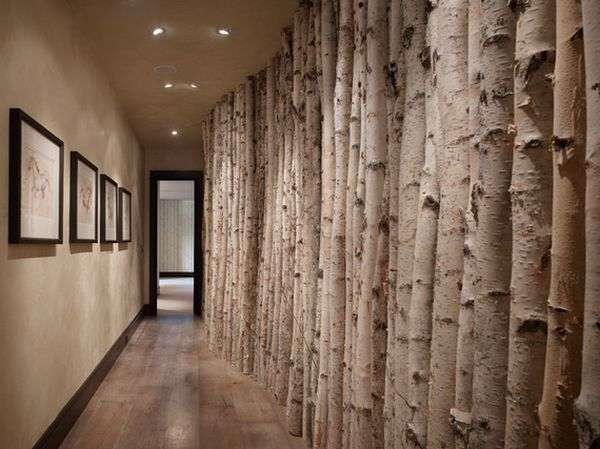 12 Ways To Use Actual Birch Trees In Your Home ~The birch trees give this long hallway a very interesting look. Arranged side by side along the wall, the trees impress with their beautiful texture and color. In fact, the color of the bark closely matches that on the wall and ceiling~