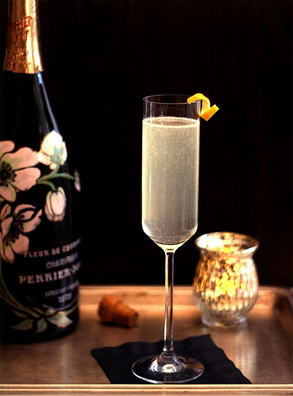 The French 75 - A Perfect Cocktail for New Years! 3 ounces gin, 3 ounces fresh lemon juice, 4 teaspoons  superfine granulated sugar,1 1/2 cups ice cubes, 1 cup chilled champagne,  lemon twists for garnish.