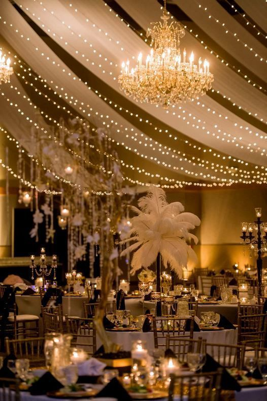Party Decorating Ideas and Inspirations | gathering | party | feathers | white sheers | lighting