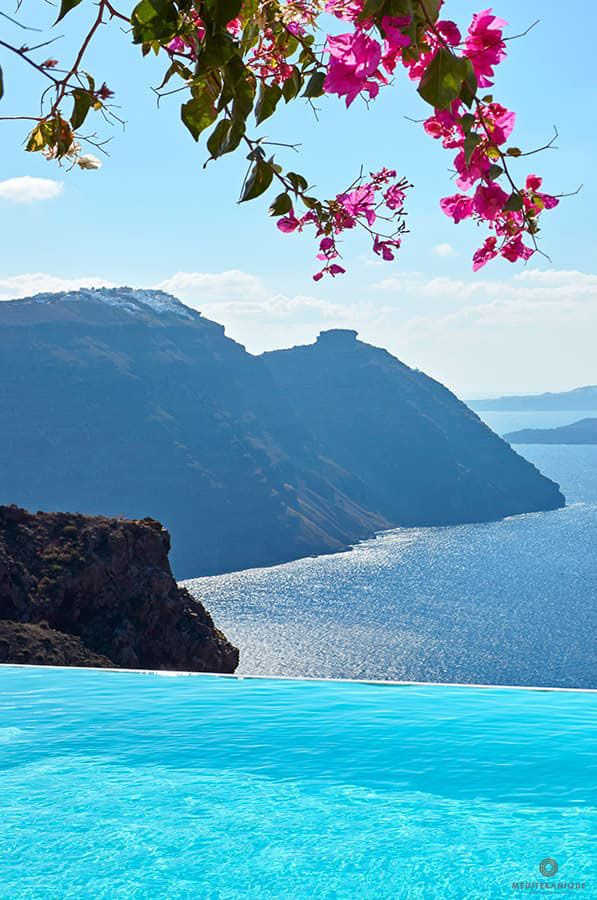 Breathtaking views from the infinity pool at the San Antonio Hotel in Santorini, Greece