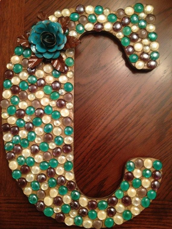So cute. And itd be pretty inexpensive to make. Someones initial decorated with gems. Makes a great DIY gift when you really dont know what to get