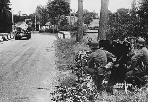 German troops secure a road on the other side of the Loire, France, during World War II - pin by Paolo Marzioli