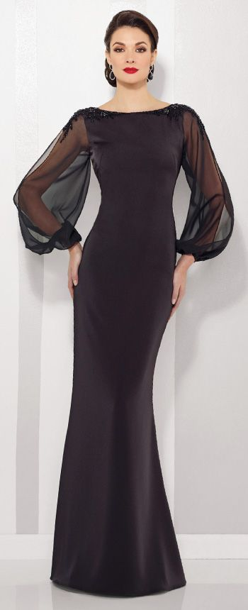 This Cameron Blake crepe and chiffon sheath features billowing illusion chiffon long sleeves with slit & cuffs, hand-beaded shoulders, & a bateau neckline.