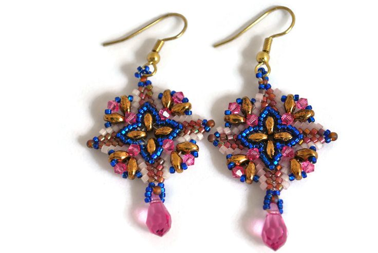 Lovely drop crystal earrings made with pink and gold Miyuki Delica cylinder glass seed beads, cobalt blue Toho glass seed beads, gold superduo beads, and Swarovski pink crystals.They measure a little