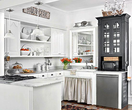 Consider different cabinetry/colors to gain eclectic style and interest in a small, white ktichen.