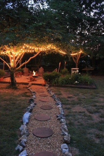 Path to fire pit with Italian light strands   #home #galleryinteriors http://galleryinteriors.com/our_work.html#_self