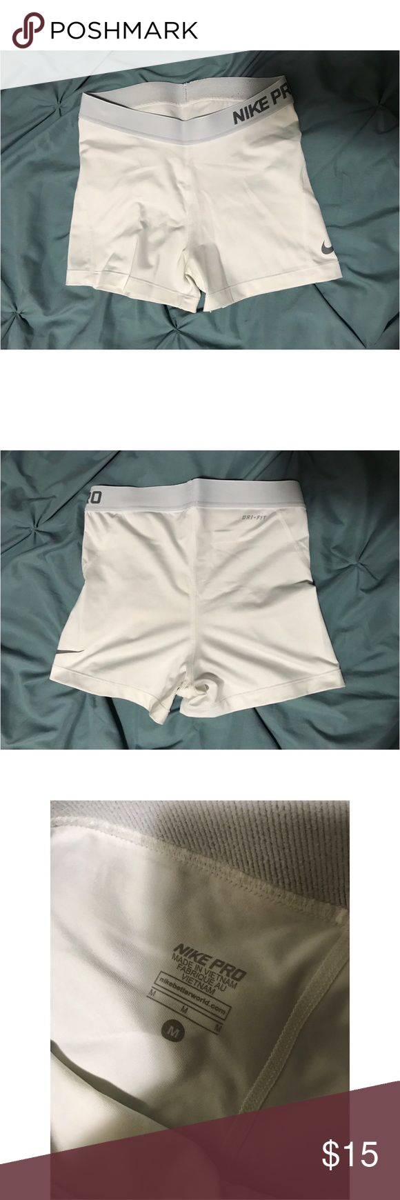 White Nike Pro Spandex Shorts White Nike Pro Spandex Shorts, size medium. Only worn a few times. Yes, they are see through.  Pet free and smoke free home. Please ask any questions or let me know if you'd like to see any other photos! Nike Shorts