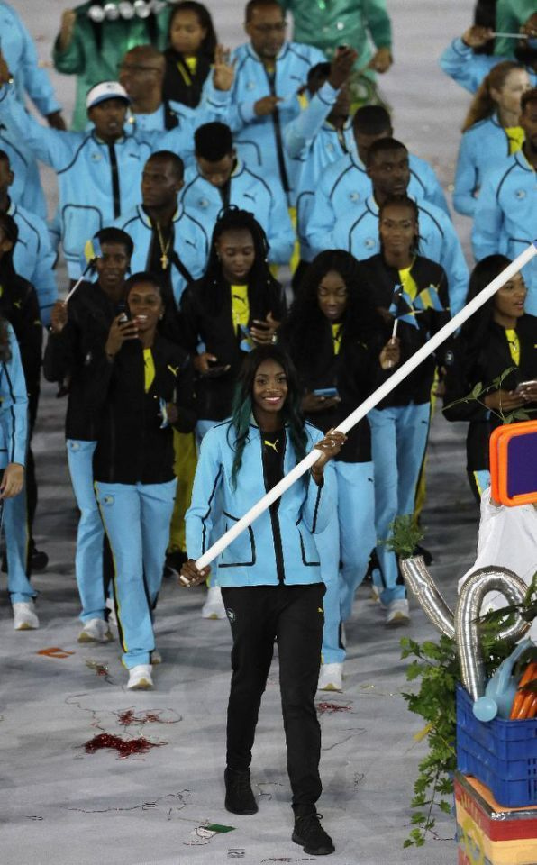 #RIO2016 Shaune Miller carries the flag of Bahamas during the opening ceremony for the 2016 Summer Olympics in Rio de Janeiro, Brazil, Friday, Aug. 5, 2016. (AP Photo/Matt Slocum)
