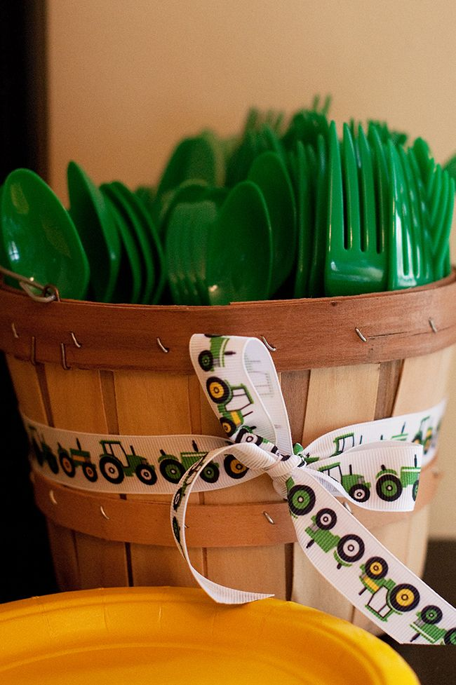 John Deere birthday party - love the ribbon!  This blog post has tons of great ideas for tractor table decorations and activities.