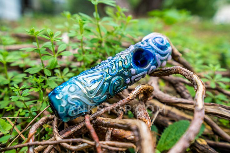 """Kobayashi Maru Steamroller by Chameleon Glass. This mini steamroller by Chameleon Glass measures in at around 5"""" in length with a 1.5"""" width. It's carb and mouthpiece are found at either end of the pipe, and its bowl's placement is located at around 1.5"""" in from its end. The glass hand pipe is made using 4mm thick glass throughout it, and features a textured raised glass swirl coil design worked on the entirety of the length of the steamroller, giving it a beautiful one-of-a-kind appearance."""