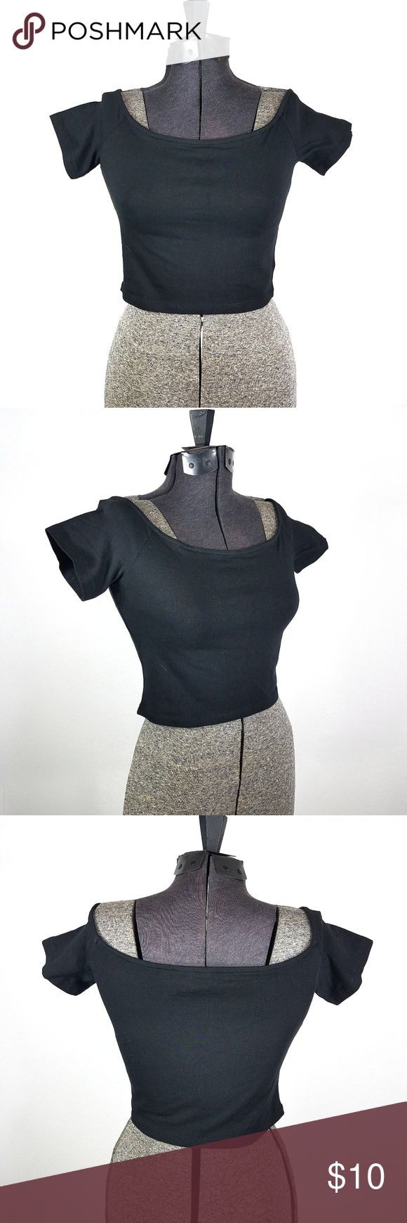 "H&M Divided Crop Top Short Sleeve Black Cotton S H&M Divided Size Small Cotton Blend Great preowned condition with no holes or stains  This crop top from H&M is super cute and very comfortable. It features short sleeves and a scoop neckline, almost off the shoulders.   Measurements laying flat: Length:13""  Bust:15""  Waist:13""  Sleeve:4"" H&M Tops Crop Tops"