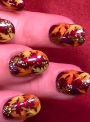 brown nails with orange and red leaves thanksgiving nail art check out www.MyNailPolishObsession.com for more nail art ideas.